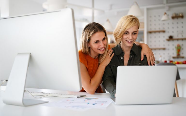 Startup business partners women working together in office